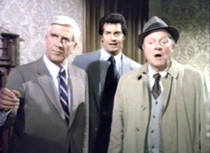 Police Squad!'s leads. That's Leslie Nielsen on the left. Now you remember?